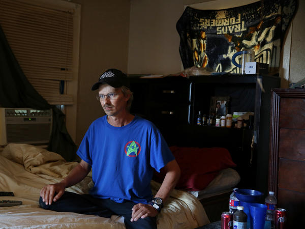 Joe Becker at his home in Abilene, Texas. Nearly two years after hurting his back at work, his benefits have stopped even though he's still in pain and in need of another surgery.