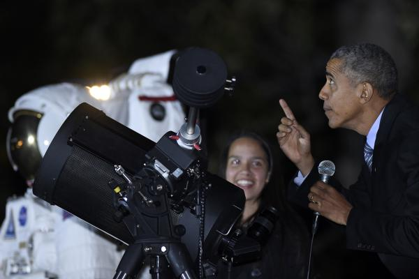 President Obama checks out the moon as he talks with Agatha Sofia Alvarez-Bareiro, a high school senior from Brooklyn, N.Y. The occasion was the second-ever White House Astronomy Night.