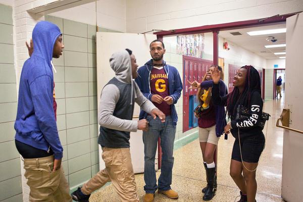 Taylor watches students following an incident during class. Mentors often help teachers intervene.