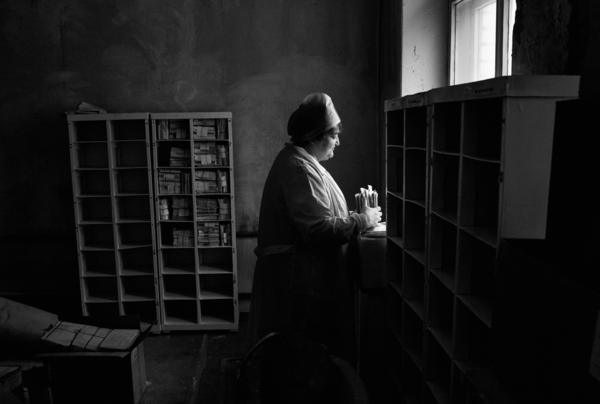 A nurse organizes the files of deceased patients at a TB hospital in Togliatti, Russia. Multi-drug-resistant tuberculosis is a huge problem in the former Soviet Union.