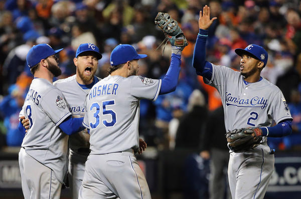 Mike Moustakas #8, Ben Zobrist #18, Eric Hosmer #35 and Alcides Escobar #2 of the Kansas City Royals celebrate after defeating the New York Mets by a score of 5-3 to win Game Four of the 2015 World Series at Citi Field on Saturday night.