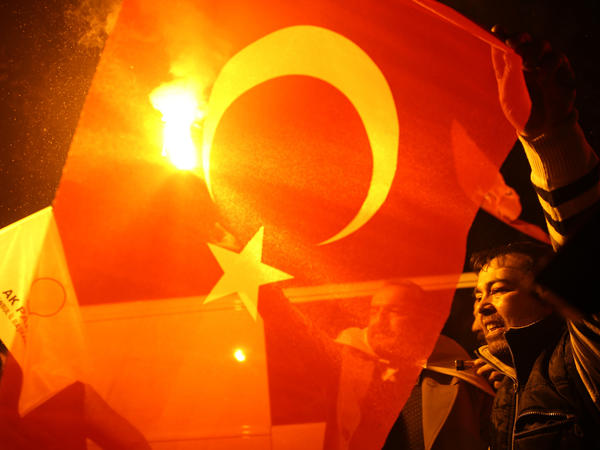 Supporters of Turkey's President Recep Tayyip Erdogan and the Justice and Development Party (AKP) celebrate a decisive win in parliamentary elections Sunday.