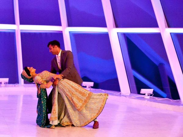 """Tariq and Ummehaany Azam dance to """"Fly Me to the Moon"""" at their wedding reception."""