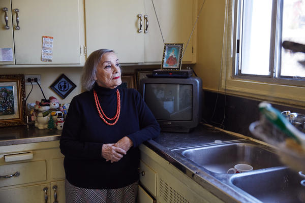 Lydia Smith stands in the kitchen of her home in the Westlake neighborhood of Los Angeles. She has lived in this apartment for 46 years, and now that she is on a fixed income, she pays rent with the aid of Section 8 tenant-based assistance.