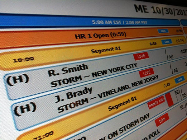 The rundown board, like this <em>Morning Edition</em> one shown during Hurricane Sandy, displays the schedule of segments which make up each NPR show. When big news breaks, the planned rundown may be changed completely.