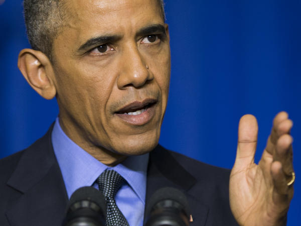 President Barack Obama speaks during a news conference at the Organization for Economic Cooperation and Development Centre, in Paris, discussed climate change, the threat of terrorism and the shootings at a Colorado Planned Parenthood clinic last week.