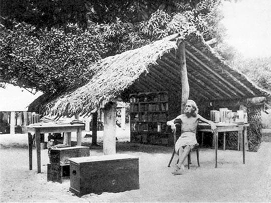 German nudist August Engelhardt sits in front of his thatched tent-like hut on the island of Kabakon (in what is now Papua New Guinea) with the books that he brought with him from Germany. In 1902, he moved to the South Pacific to start a utopian cult that revolved around two orbs: the coconut and the sun.