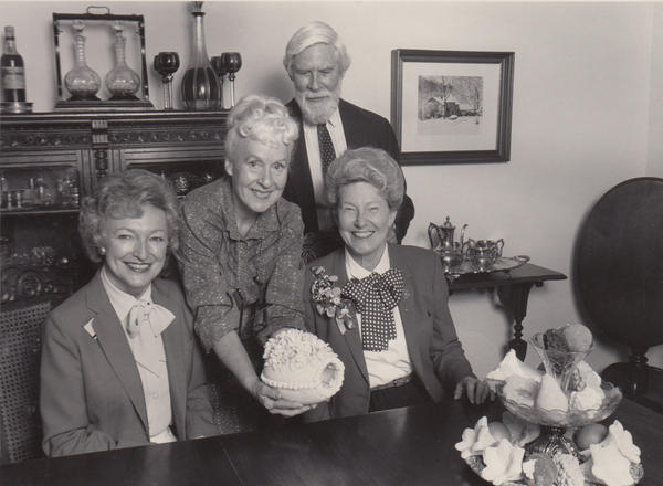 """Phila Hach (standing, center) and her husband, Adolf Hach, are seen here with Minnie Pearl (right) of Grand Ole Opry fame, and an unidentified woman. """"What the Grand Ole Opry did for country music, she has done for Southern food,"""" one food writer wrote about Hach."""