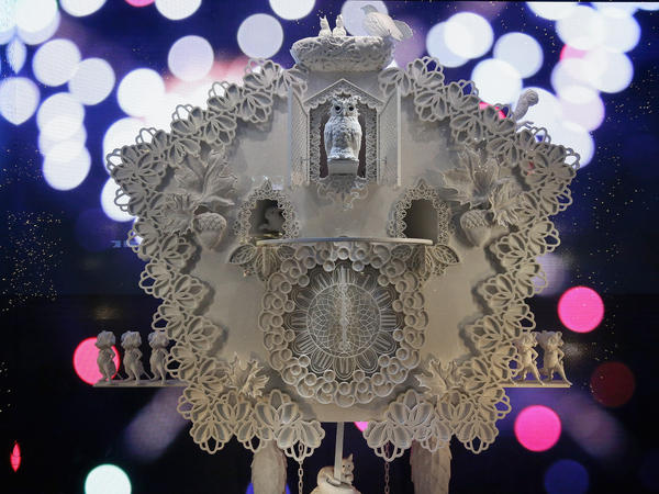 The cuckoo clock is showcased in one of five Lord and Taylor window displays. At midnight, a fireworks animation explodes in the background.