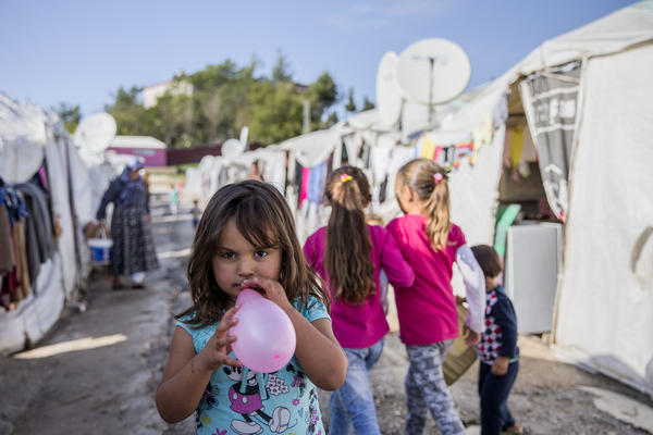 A refugee from Syria plays with a balloon at a camp in Turkey.