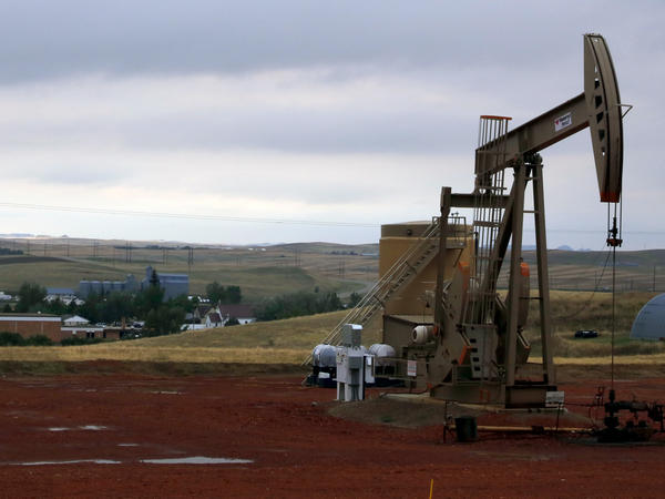 The lifting of the ban could be a boon for domestic oil producers. Above, an oil pump near Alexander, N.D, in September.