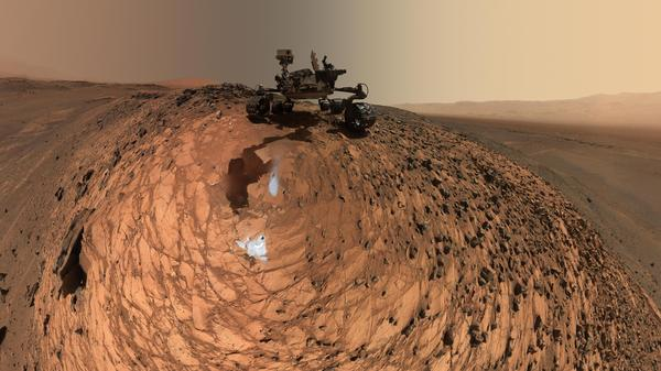 """After it drilled two holes in the """"Buckskin"""" rock on Mars, the Curiosity rover took a series of photos that were turned into this panoramic self-portrait. The rover is sitting on the crest of a 20-foot hill."""