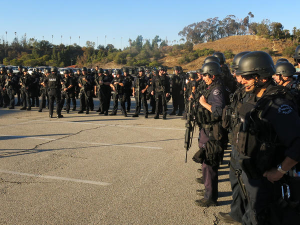 Members of the Los Angeles Police Department's elite Metropolitan Division participate in a simulation of a Paris-style coordinated attack. The team was tested on response time to converge on this site.