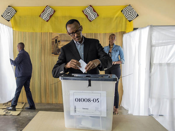 President Paul Kagame posted his ballot in Kigali on Friday as Rwandans voted in a referendum to decide whether he should be allowed to extend his time in power.