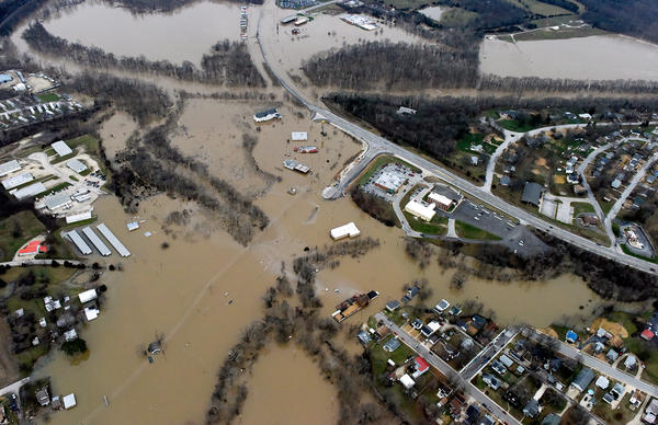 Submerged roads and houses are seen after several days of heavy rain led to flooding, in an aerial view over Union, Mo., on Tuesday.