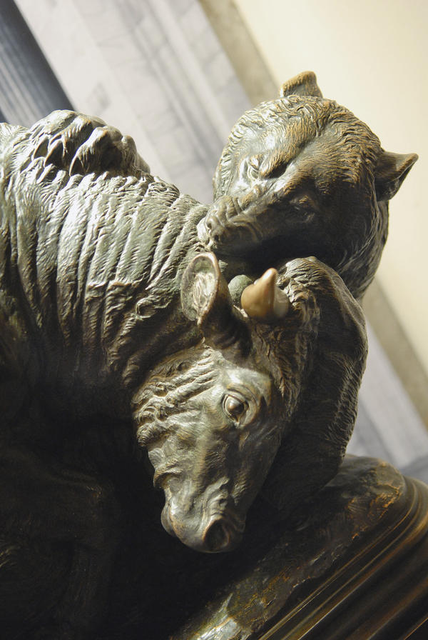 This statue in the Museum of American Finance symbolizes the struggle of the marketplace, says Chris Meyers, the museum's director of education. The statue used to sit outside the breakfast club at the New York Stock Exchange and members would rub the bull's horns for good luck.