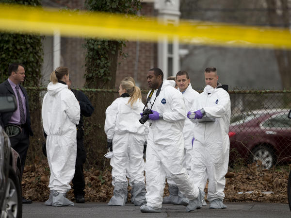 Investigators prepare to enter one of the residences where suspect Edward Archer lived in Yeadon, Pa. Archer is accused of ambushing a police officer in Philadelphia on Jan. 7. The FBI has said it is investigating the attack as a possible act of terrorism — inspired by ISIS.