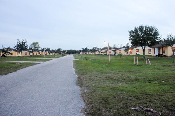 Some employers build special housing compounds just for their H-2A workers. About 300 workers live in this fenced compound.