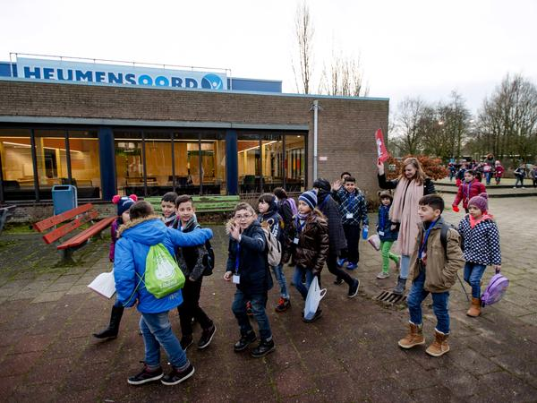 Children from a refugee camp in the Dutch city of Nijmegen arrive for their first day of school last month.