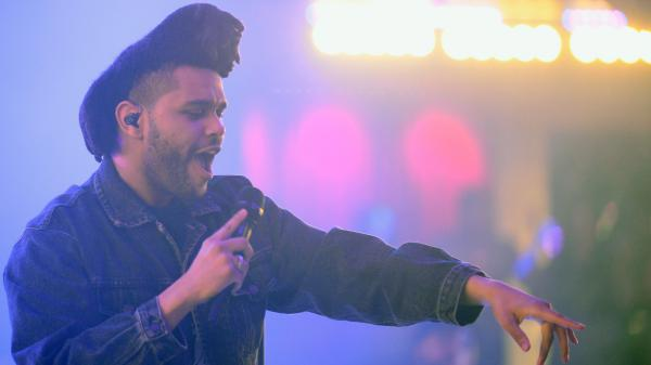 "The Weeknd —€"" known for his falsetto range —€"" performs in Las Vegas earlier this year."