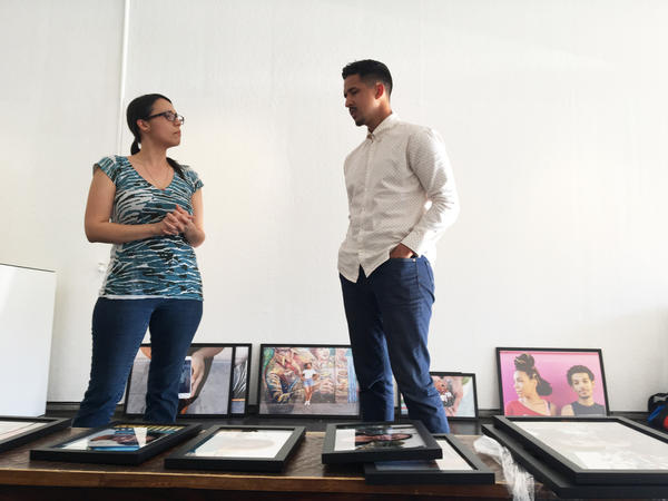 Curator Nathalie Sanchez and Walter Thompson-Hernandez set up an exhibit of his photos at a gallery in Los Angeles.