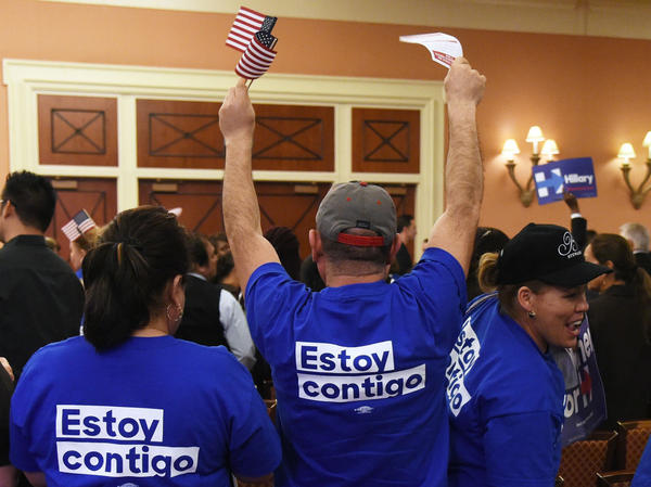 Hispanic Hillary Clinton supporters react during a Democratic caucus at Caesars Palace on February 20, 2016 in Las Vegas, Nevada. (Ethan Miller/Getty Images)