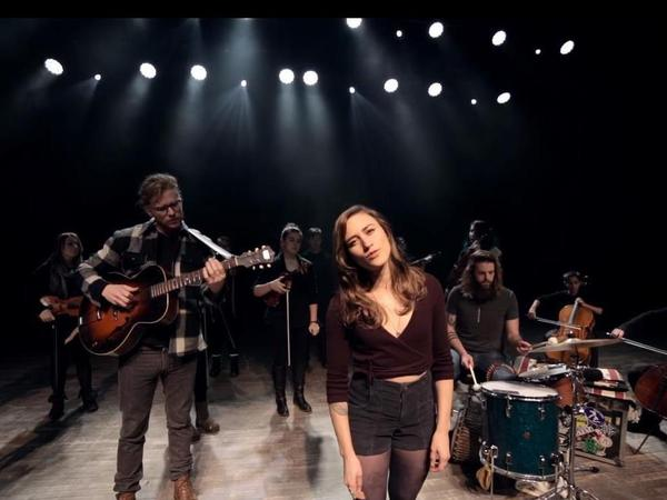 """The Ballroom Thieves, with members of the Maine Youth Rock Orchestra, in a scene from the video for the song """"Bury Me Smiling."""""""