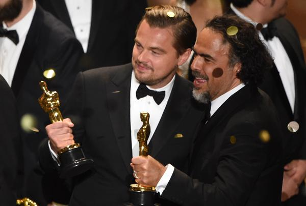 Leonardo DiCaprio and director Alejandro Gonzalez Inarritu celebrate their awards on stage at the 88th Oscars on Sunday.