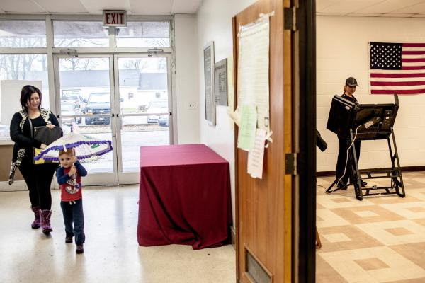 A voter casts her ballot at the polling location inside the county's courthouse building in Marion, Ark. Arkansas had 40 Republican delegates and 32 Democratic delegates at stake in its primaries.