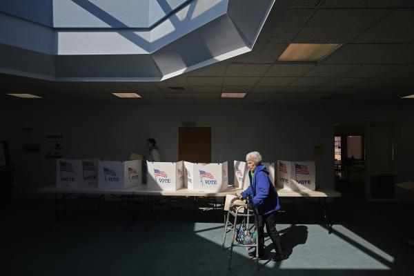 Primary voters cast their ballots Tuesday at Fairfax Circle Baptist Church in Fairfax, Va.