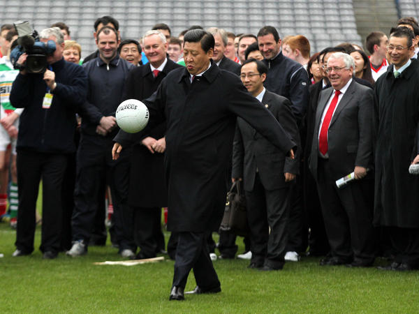 Xi Jinping, an avowed soccer fan, kicks a Gaelic football during a 2012 trip to Dublin when he was China's vice president. Xi became president the following year.