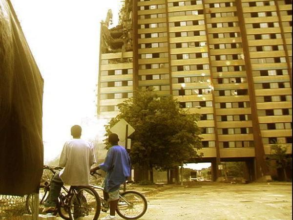 This still from the documentary film <em>East of Liberty</em> shows two young boys in Pittsburgh looking up at a building facing demolition.