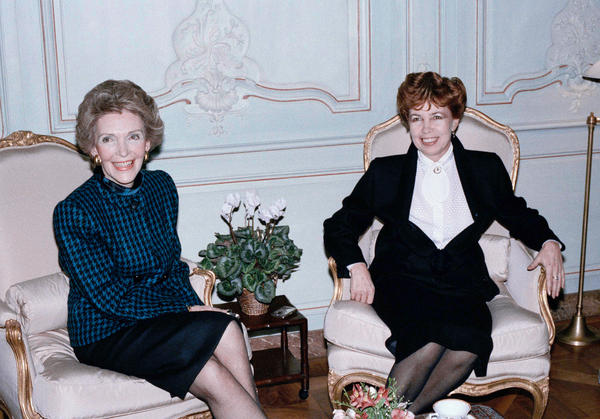 Nancy Reagan (left) and Soviet first lady Raisa Gorbachev both smile politely during a tension-filled tea in Geneva in 1985, while their husbands discussed nuclear disarmament.