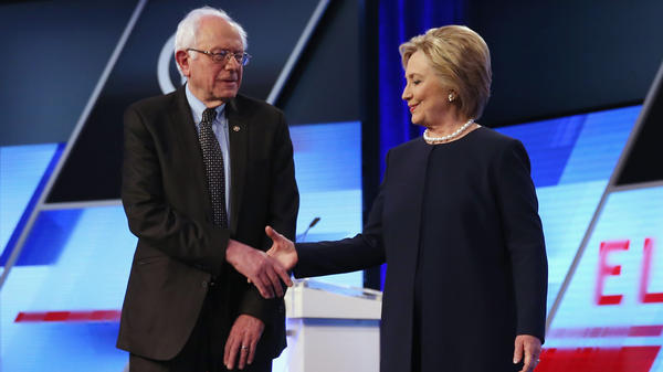 Bernie Sanders and Hillary Clinton before the Univision News and <em>Washington Post</em> debate on the Miami Dade College Kendall Campus on Wednesday in Miami.