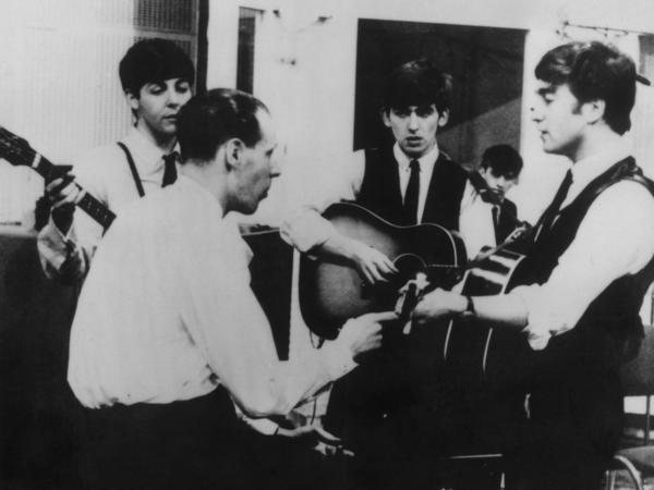 Producer George Martin in a recording session with The Beatles.