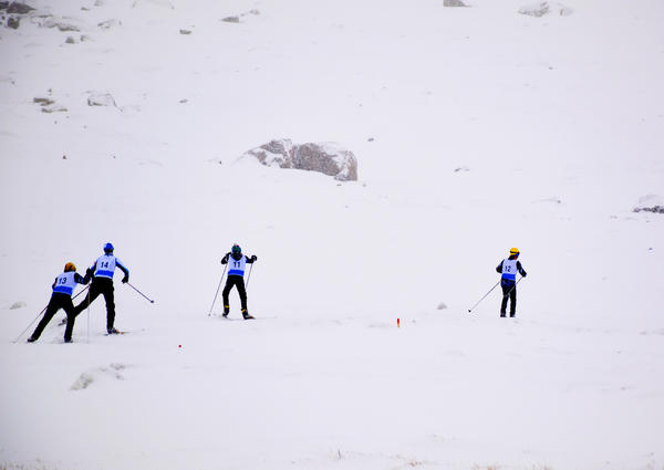 Teenagers compete in a sprint biathlon in Nuuk, Greenland, during the Arctic Winter Games.