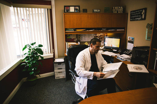 """For a long time, Dr. William Cooke was the only doctor in town. Cooke's staff goes door-to-door to make sure people are keeping their appointments. """"When somebody walks in my door with HIV, I hug them, """" he says."""