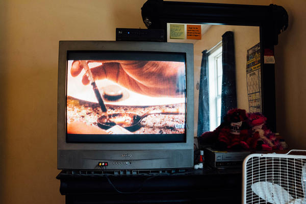 A TV commercial showing IV drug use plays in the room where Opana was injected.