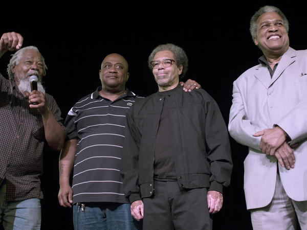 "Albert Woodfox, (second from right), with his brother Michael Mable (second from left) at the Ashe Cultural Arts Center in New Orleans in February. Woodfox of the ""Angola Three,"" had just been released from Louisiana State Penitentiary."