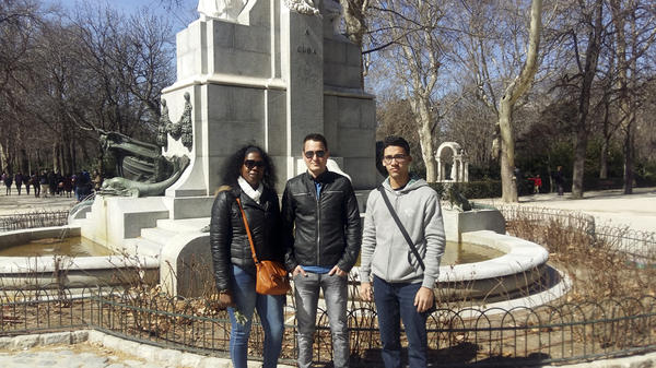 Jaqueline Madrazo Luna (left), Rafael León (center) and Ernesto Oliva Torres, pose in front of a Cuba monument in Madrid's Retiro Park. The Cuban government granted them two-week travel permits to visit Spain. They are meeting with the Cuban Observatory of Human Rights, which includes exiled Cuban activists.