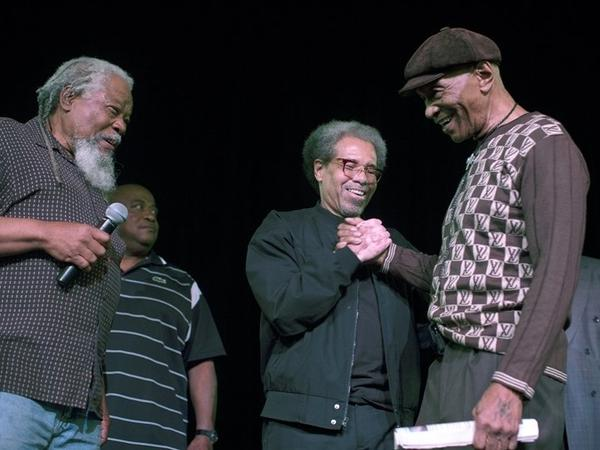 Albert Woodfox (center) is greeted by Robert King (right) at the Ashe Cultural Arts Center in New Orleans on Feb. 19, after his release from Louisiana State Penitentiary that day.