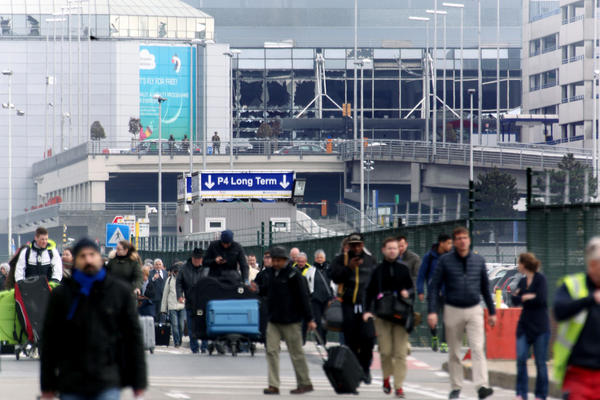 People are evacuated from the Zaventem international airport after a terrorist attack early Tuesday in Brussels.