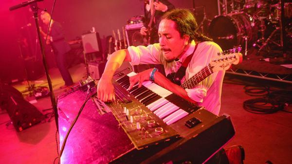 Bardo Martinez of Chicano Batman balances guitar and keys at our showcase.
