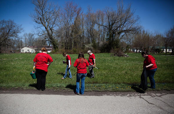 Volunteers search for used needles near Rural Street in Austin, Ind. Scott County, in southeastern Indiana, experienced the worst outbreak of HIV in the state's history after people began injecting the prescription painkiller Opana.