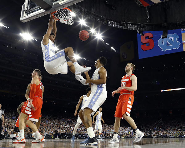 North Carolina's Isaiah Hicks (4) dunks during the first half of the NCAA Final Four tournament college basketball semifinal game against Syracuse, Saturday, April 2, in Houston.