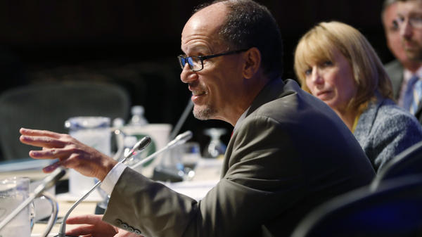 """Labor Secretary Tom Perez speaks at a governors meeting in July. Under current rules, advisers """"say things like 'we put our clients first,' """" Perez said this week. Going forward, """"this is no longer a slogan. It's the law."""""""