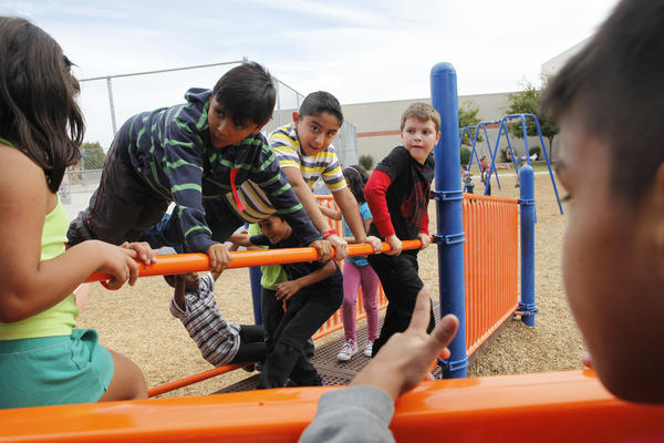 Humberto Araujo (center) is a second-grader who was identified as gifted at Echo Mountain Primary School in Arizona. If he went to a school across the state, it's possible he would never have been noticed.