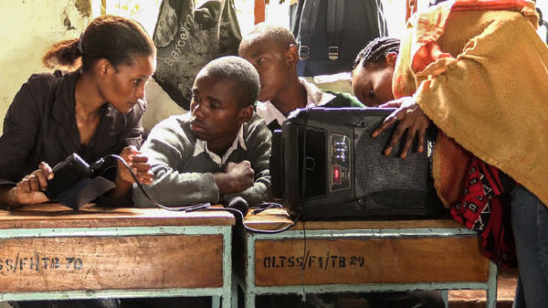 High school students in Tanzania gather in a Mental Health Listening Club — first comes the soap opera, then the chance to ask questions about topics like depression.