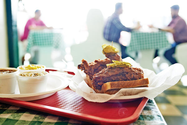The staple at legendary Prince's is fiery hot fried chicken, always served on white bread, with pickles.