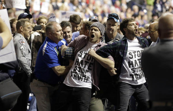 Protesters are removed as Republican presidential candidate Donald Trump speaks during a campaign rally in Fayetteville, N.C., Wednesday, March 9, 2016.
